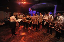 Teh Ida's turn to conduct the angklung ensemble